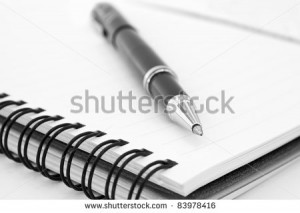 stock-photo-notebook-and-pen-in-composition-in-black-and-white-83978416